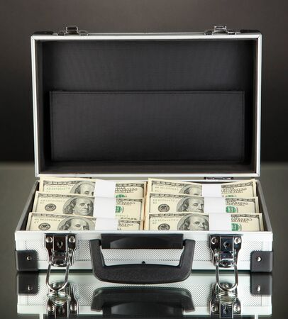 Suitcase with 100 dollar bills on black background Stock Photo - 17332504