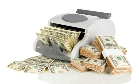 Machine for counting money and 100 dollar bills isolated on white Stock Photo - 17332082