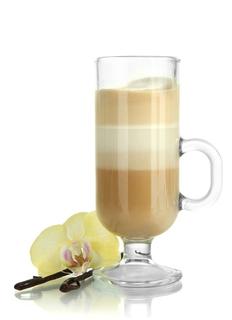 Fragrant coffee latte in glass cup with vanilla pods isolated on white photo