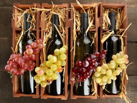 bordeau: Wooden case with wine bottles on wooden table Stock Photo