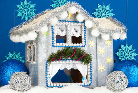 Decorated Christmas house on blue background Stock Photo - 17349432