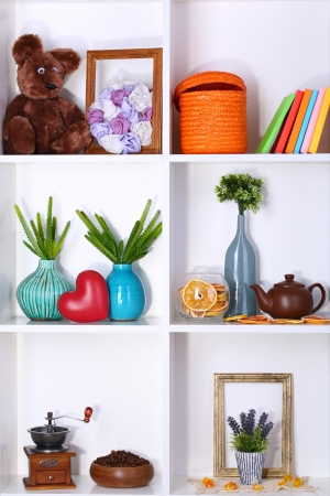 Beautiful white shelves with different home related objects Stock Photo - 17349712