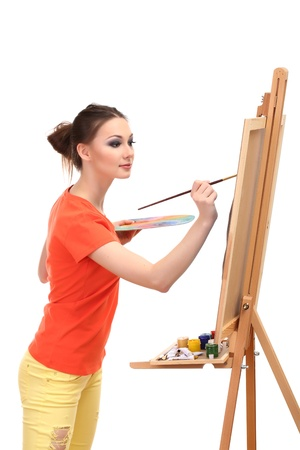 beautiful young woman painter at work, isolated on white photo