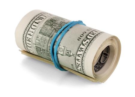 Twisted bundle 100 dollar bills isolated on white Stock Photo - 17396187