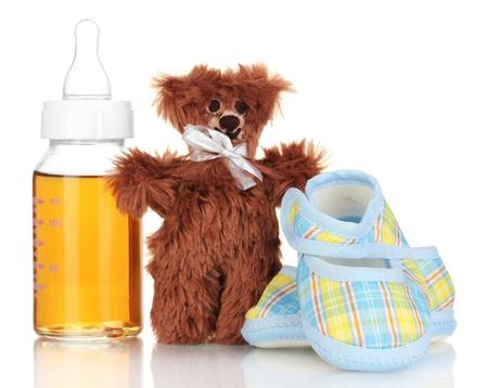 Baby bottle with fresh juice isolated on white Stock Photo - 17400246