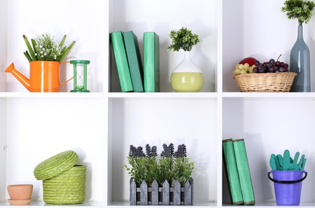 Beautiful white shelves with different gardening related objects Stock Photo - 17400953