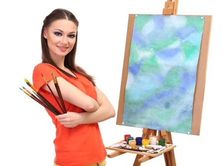 beautiful young woman painter with brushes, isolated on white photo