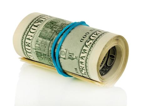 Twisted bundle 100 dollar bills isolated on white Stock Photo - 17399140