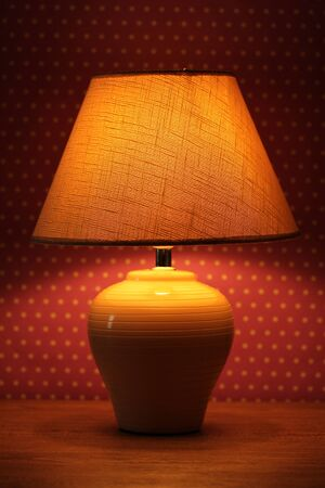 table lamp on wallpaper background  Stock Photo - 17404081
