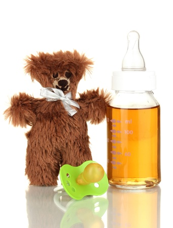 Baby bottle with fresh juice and teddy bear isolated on white Stock Photo - 17403607