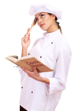 culinary skills: Portrait of young woman chef with cook book isolated on white