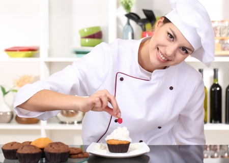 cupcakes bars young woman chef cooking cake in kitchen