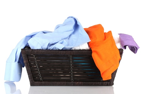creased: Bright clothes in laundry basket, isolated on white