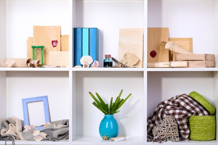 Beautiful white shelves with different travel related objects Stock Photo - 17404098