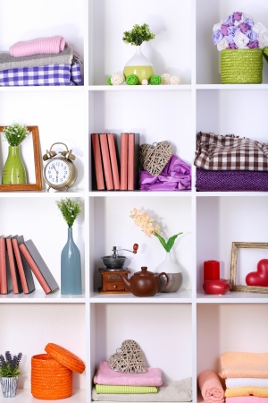 Beautiful white shelves with different home related objects Stock Photo - 17404103