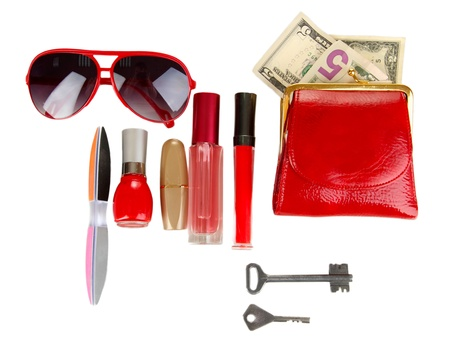 contained: Items contained in the womens handbag isolated on white Stock Photo