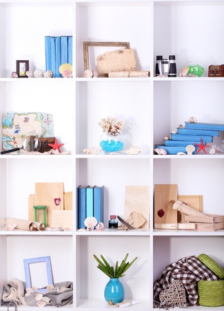 Beautiful white shelves with different travel related objects Stock Photo - 17404050