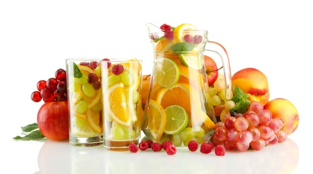 transparent jar and glasses with exotic  fruits, isolated on white photo