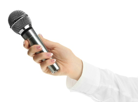 female hand with microphone isolated on white photo