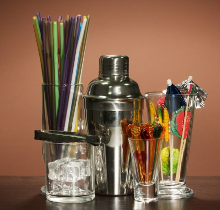 Cocktail shaker and  other bartender equipment on color background Stock Photo - 17459385