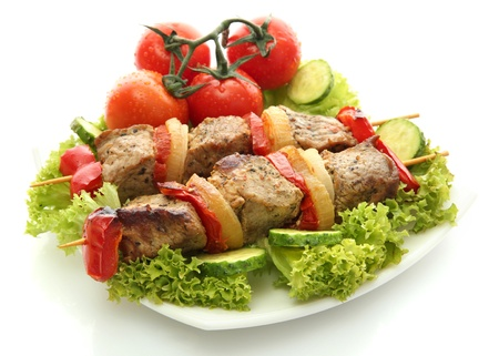 tasty grilled meat and vegetables on skewers on plate, isolated on white Stock Photo - 17459358