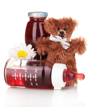 Baby bottle with fresh juice and teddy bear isolated on white Stock Photo - 17459270
