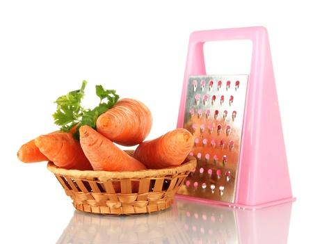 carrots with grater isolated on white photo