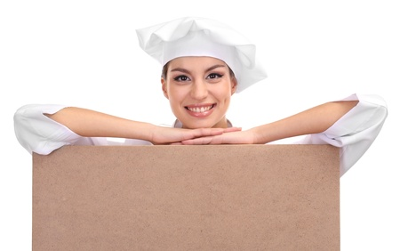 culinary skills: portrait of young woman chef with empty board isolated on white Stock Photo