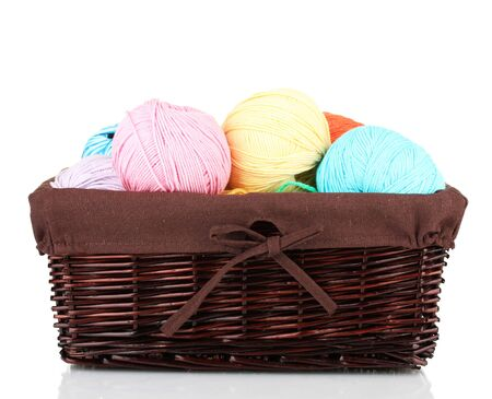 weave ball: Colorful yarn balls in wicker basket isolated on white Stock Photo