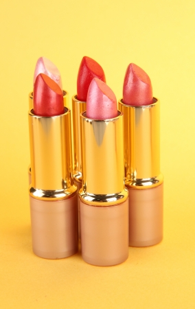 Lipsticks on yellow background Stock Photo - 17459240