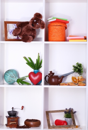 Beautiful white shelves with scattered different home related objects Stock Photo - 17459564