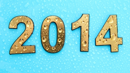 2014 in golden numbers, on blue background photo