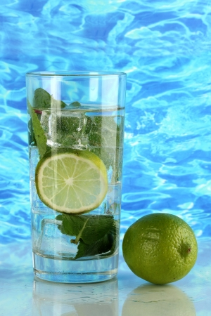 Glass of water with ice, mint and lime on sea background Stock Photo - 17463442