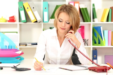 Beautiful young business woman working in office Stock Photo - 21537630
