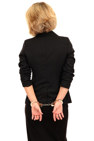 handcuffs woman: Young beautiful business woman in handcuffs isolated on white