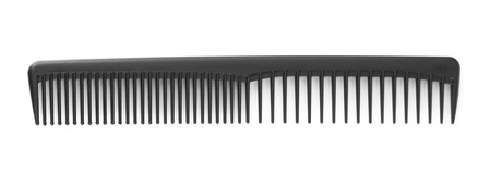 Black comb isolated on white photo