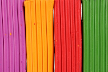 chaotically: Children bright plasticine background close-up Stock Photo