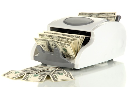 Machine for counting money and 100 dollar bills isolated on white Stock Photo - 17485681