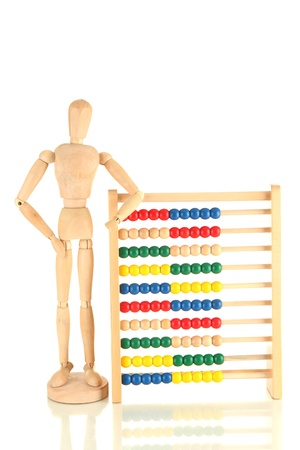 Bright toy abacus and wooden dummy, isolated on white Stock Photo - 17485389