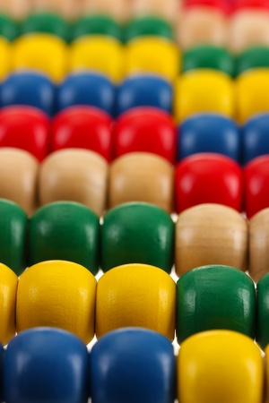 Bright wooden toy abacus, close up photo
