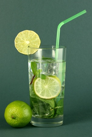 Glass of water with ice, mint and lime on grey background Stock Photo - 17485859