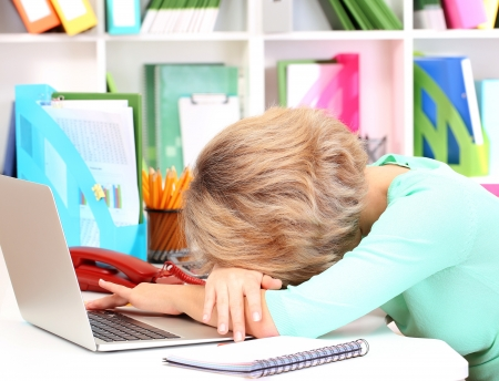 abatis: Tired business woman working in office Stock Photo