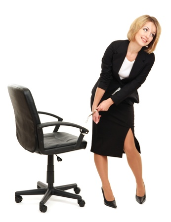 handcuffs girl: Young beautiful business woman strapped to chair with handcuffs isolated on white Stock Photo