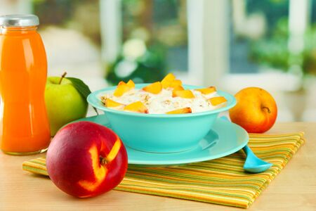 tasty dieting food and bottle of juice, on wooden table Stock Photo - 17518622