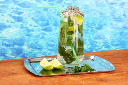 Mojito on tray on blue background Stock Photo - 17518668