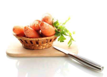 carrots in basket with knife isolated on white photo