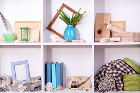 Beautiful white shelves with different travel related objects Stock Photo - 17518680