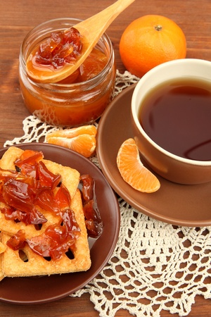 light breakfast with tea and homemade jam, on wooden table Stock Photo - 17518671