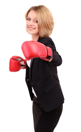 careerists: Young beautiful business woman with boxing gloves isolated on white
