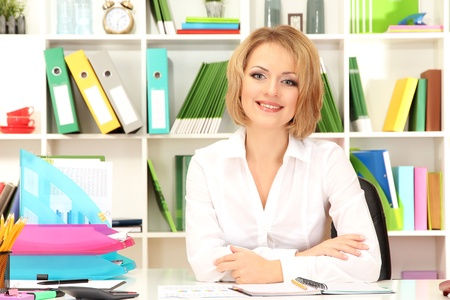 careerists: Young beautiful business woman in office at her workplace